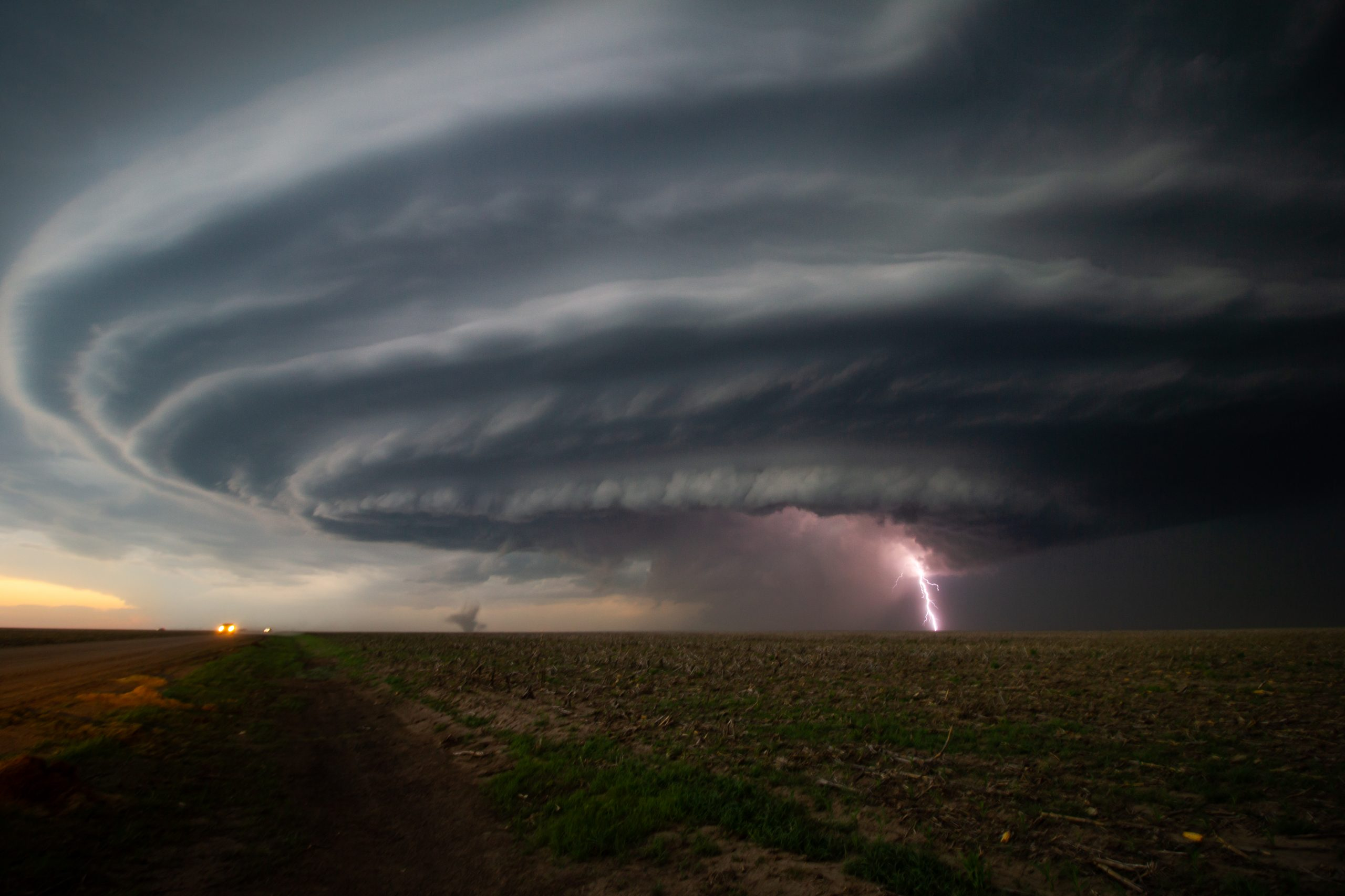 The Mothership! A large supercell thunderstorm with lightning and a small tornado over fields in Kansas, U.S.A., June 2019 (pic: @fitzpatricknoel). This was one of the most impressive and beautiful storms the team encountered on their trip.